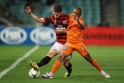 Shannon Cole of the Wanderers competes with Henrique of the Roar during the round four A-League match between the Western Sydney Wanderers and Brisbane Roar at Pirtek Stadium on December 3, 2014 in Sydney, Australia.