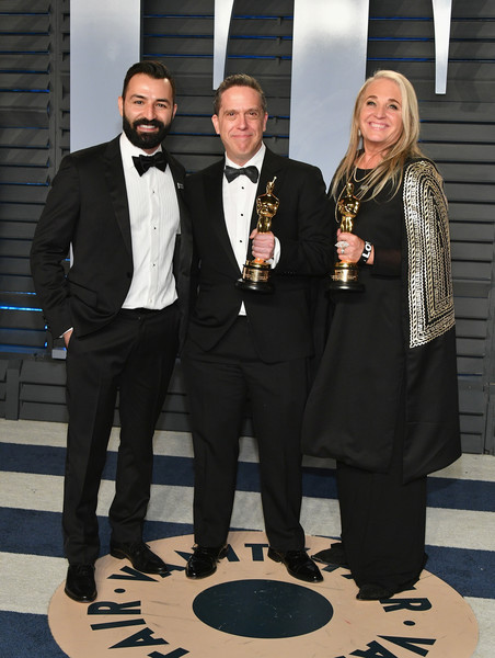 2018 Vanity Fair Oscar Party Hosted By Radhika Jones - Arrivals [suit,formal wear,tuxedo,event,white-collar worker,businessperson,award,official,radhika jones - arrivals,radhika jones,darla k. anderson,adrian molina,lee unkrich,l-r,california,beverly hills,oscar party,vanity fair]