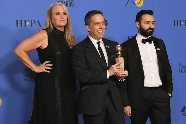 75th Annual Golden Globe Awards - Press Room [best motion picture,event,award,suit,award ceremony,premiere,formal wear,tuxedo,carpet,white-collar worker,darla k. anderson,lee unkrich,adrian molina,coco,l-r,room,press room,the beverly hilton hotel,golden globe awards]