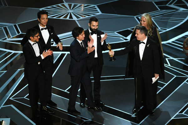 90th Annual Academy Awards - Show [performance,formal wear,suit,stage,event,tuxedo,music,musical ensemble,performing arts,musician,darla k. anderson,adrian molina,actors,benjamin bratt,gael garcia bernal,lee unkrich,academy awards,l-r,hollywood highland center,show]