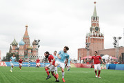 """Juan Pablo Sorin (L) and  Diego Forlan compete during the Legends Football Match in """"The park of Soccer and rest"""" at Red Square on July 11, 2018 in Moscow, Russia."""