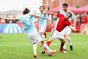 """Diego Forlan (C) controls the ball during the Legends Football Match in """"The park of Soccer and rest"""" at Red Square on July 11, 2018 in Moscow, Russia."""