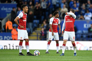 Pierre-Emerick Aubameyang of Arsenal and Aaron Ramsey of Arsenal look dejected after Leicester City score during the Premier League match between Leicester City and Arsenal at The King Power Stadium on May 9, 2018 in Leicester, England.