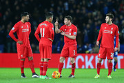 (L to R) Emre Can, Roberto Firmino, James Milner and Adam Lallana of Liverpool react after Leicester City's first goal during the Barclays Premier League match between Leicester City and Liverpool at The King Power Stadium on February 2, 2016 in Leicester, England.