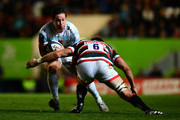Henry Chavancy of Racing 92 is tackled by Michael Fitzgerald of Leicester Tigers during the European Rugby Champions Cup match between Leicester Tigers and Racing 92 at Welford Road on October 23, 2016 in Leicester, United Kingdom.