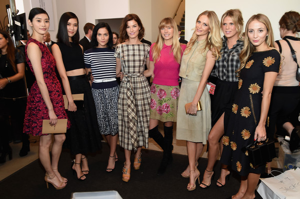 Michael Kors Fall 2015 Runway Show - Backstage [michael kors,tao okamoto,ming xi,poppy delevingne,alexandra richards,jessica hart,hanneli mustaparta,leigh lezark,l-r,fashion,social group,event,dress,fashion design,design,party,style,team,performance,backstage]
