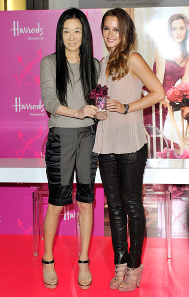 Vera Wang (L) poses with Leighton Meester (R) to promote her new perfume 'Vera Wang Lovestruck' at Harrods on June 9, 2011 in London, England.