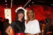 Senna Guemmour and Wanda Badwal attend the Lena Hoschek show during the Mercedes-Benz Fashion Week Spring/Summer 2015 at Erika Hess Eisstadion on July 8, 2014 in Berlin, Germany.