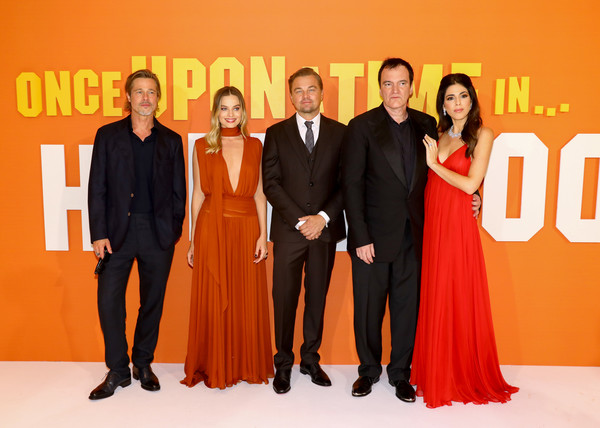 'Once Upon A Time In Hollywood' UK Premiere [formal wear,event,fashion,orange,carpet,suit,dress,premiere,fashion design,flooring,quentin tarantino,daniela tarantino,leonardo dicaprio,brad pitt,margot robbie,once upon a time... in hollywood,l-r,uk,odeon luxe leicester square,premiere]