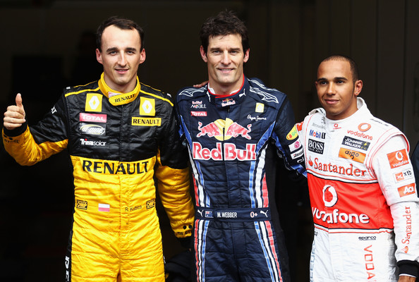 Lewis Hamilton Pole sitter Mark Webber (C) of Australia and Red Bull Racing celebrates in parc ferme with second placed Lewis Hamilton (R) of Great Britain and McLaren Mercedes and third placed Robert Kubica (L) of Poland and Renault following qualifying for the Belgian Formula One Grand Prix at the Circuit of Spa Francorchamps on August 28, 2010 in Spa Francorchamps, Belgium.