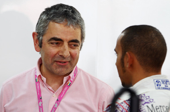 Lewis Hamilton Lewis Hamilton (R) of Great Britain and McLaren talks with actor Rowan Atkinson (L) in the McLaren garage during qualifying for the Indian Formula One Grand Prix at the Buddh International Circuit on October 29, 2011 in Noida, India.