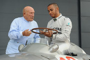 Sir Stirling Moss shows Mercedes AMG Petronas F1 driver Lewis Hamilton the Grand Prix- winning Mercedes- Benz W196 at Silverstone Circuit on May 31, 2013 in Northampton, England.