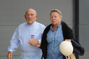 Sir Stirling Moss and wife Suzie arrive at Silverstone Circuit on May 31, 2013 in Northampton, England.