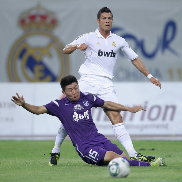 Tianjin Teda v Real Madrid - Real Madrid's China Tour [player,sports,team sport,ball game,soccer player,football player,soccer,football,sports equipment,soccer ball,cristiano ronaldo,liao bochao,bellow,ball,water drop stadium,tianjin,real madrid,tianjin teda,china tour,match]