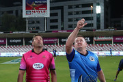 Scott Styris the Captain of Leo Lions performs the coin toss as  Jacques Kallis the Captain of Libra Legends looks on prior to the Oxigen Masters Champions League match between the Libra Legends and Leo Lions on February 7, 2016 in Sharjah, United Arab Emirates.