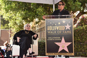 Lina Vertmuller and David O. Russell attend a ceremony honoring Lina Wertmuller with the 2,679th Star on The Hollywood Walk of Fame on October 28, 2019 in Hollywood, California.