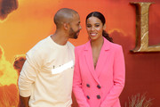 """Marvin Humes and Rochelle Humes attend """"The Lion King"""" European Premiere at Leicester Square on July 14, 2019 in London, England."""