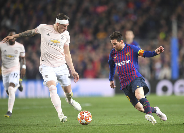 Lionel Messi and Phil Jones Photos - 1 of 13