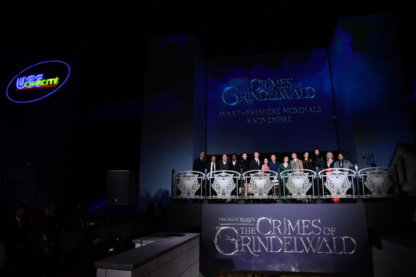 """Fantastic Beasts: The Crimes Of Grindelwald"" World Premiere At UCG Bercy In Paris [fantastic beasts: the crimes of grindelwald,stage,performance,event,design,music,performing arts,music venue,night,concert,crowd,world premiere,lionel wigram,callum turner,zoe kravitz,jude law,david yates,l-r,paris,ucg bercy]"