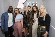 (EXCLUSIVE COVERAGE) Jade Thirlwall, Jesy Nelson, Perrie Edwards and Leigh-Anne Pinnock of Little Mix pose with KISS Breakfast presenters Melvin O'Doom and Charlie Hedges during a visit Kiss FM Studio's on October 11, 2018 in London, England.