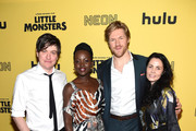 """Director Abe Forsythe, Lupita Nyong'o , Alexander England and Jodi Matterson attend the New York Premiere """"Little Monsters"""" at AMC Lincoln Square Theater on October 08, 2019 in New York City."""