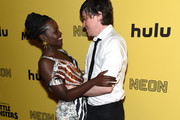 """Lupita Nyong'o and Abe Forsythe attend the New York Premiere """"Little Monsters"""" at AMC Lincoln Square Theater on October 08, 2019 in New York City."""
