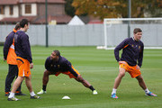Liverpool players Steven Gerrard,Glen Johnson and Stewart Downing  warm up during a training session ahead of their UEFA Europa League group match against FC Anzhi Makhachkala at Melwood Training Ground on October 24, 2012 in Liverpool, England.
