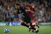 Neymar of Paris Saint-Germain runs with the ball under pressure from Georginio Wijnaldum of Liverpool during the Group C match of the UEFA Champions League between Liverpool and Paris Saint-Germain at Anfield on September 18, 2018 in Liverpool, United Kingdom.