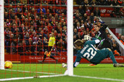 Marco van Ginkel of Stoke City (R) shoots past goalkeeper Simon Mignolet of Liverpool, but hits the post during the Capital One Cup semi final second leg match between Liverpool and Stoke City at Anfield on January 26, 2016 in Liverpool, England.