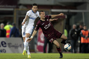 Djamel Mesbah of AS Livorno Calcio fights for the ball with Ricardo Alvarez of FC Internazionale Milano during the Serie A match between AS Livorno Calcio and FC Internazionale Milano at Stadio Armando Picchi on March 31, 2014 in Livorno, Italy.
