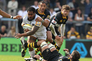 Henry Fa'afili of Leeds is tackled by Simon Shaw(on ground) and Riki Flutey during the Aviva Premiership match between London Wasps and Leeds Carnegie at Adams Park on April 17, 2011 in High Wycombe, England.