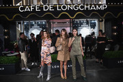 (L-R) Calu Rivero, Jeanne Damas and Patricia Manfield attend the opening of Longchamp Fifth Avenue Flagship at Longchamp on May 3, 2018 in New York City.
