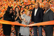 President of Lord & Taylor and Hudson's Bay Liz Rodbell (C) cuts the ribbon with (L-R) Shermaine Croney, Victoria Justice, John Starks and Michael Pollard during the Lord & Taylor Stamford Grand Re-Opening celebration on December 1, 2016 at Lord & Taylor Stamford in Stamford, Connecticut.