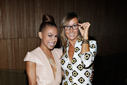 Actress Toni Trucks and fashion designer Nikki Poulos attend the Loris Diran fashion show during Mercedes-Benz Fashion Week at the DiMenna Center on September 12, 2013 in New York City.
