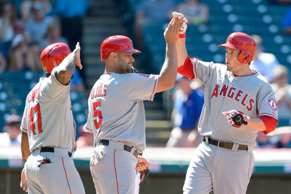 Howie Kendrick #47 and Albert Pujols #5 celebrate with David Freese #6 of the Los Angeles Angels of Anaheim after all scored on a three run home run by Freese during the fifth inning against the Cleveland Indians at Progressive Field on September 8, 2014 in Cleveland, Ohio.