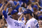 Eric Hosmer #35 of the Kansas City Royals celebrates his two-run home run with Salvador Perez #13 of the Kansas City Royals in the sixth inning against the Los Angeles Angels of Anaheim at Kauffman Stadium on August 14, 2015 in Kansas City, Missouri.