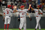 (L-R) Ian Kinsler #3, Mike Trout #27, Zack Cozart #7 and Chris Young #24 of the Los Angeles Angels of Anaheim celebrate defeating the Minnesota Twins 4-2 after the game on June 8, 2018 at Target Field in Minneapolis, Minnesota. The Angels defeated the Twins 4-2.
