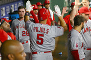 Albert Pujols #5 of the Los Angeles Angels of Anaheim is congratulated for hitting a solo home run in the second inning against the Texas Rangers at Globe Life Park in Arlington on August 18, 2018 in Arlington, Texas.