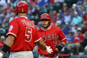 David Fletcher #6 of the Los Angeles Angels celebrates a run with Albert Pujols #5 in the first inning against the Texas Rangers at Globe Life Park in Arlington on August 16, 2018 in Arlington, Texas.