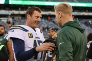 Philip Rivers #17 of the Los Angeles Chargers and Josh McCown #15 of the New York Jets meet after an NFL game at MetLife Stadium on December 24, 2017 in East Rutherford, New Jersey. The Los Angeles Chargers defeated the New York Jets 14-7.