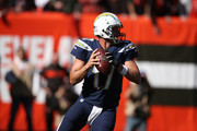 Philip Rivers #17 of the Los Angeles Chargers looks to pass in the first half against the Cleveland Browns at FirstEnergy Stadium on October 14, 2018 in Cleveland, Ohio.