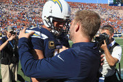 Quarterback Philip Rivers #17 of the Los Angeles Chargers shakes hands with head coach Sean McVay of the Los Angeles Rams after the Rams defeated the Chargers 35-23 at Los Angeles Memorial Coliseum on September 23, 2018 in Los Angeles, California.