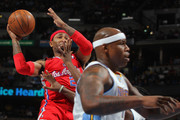 Mo Williams #25 of the Los Angeles Clippers looks to pass the ball against Al Harrington #7 of the Denver Nuggets at Pepsi Center on April 18, 2012 in Denver, Colorado. The Clippers defeated the Nuggets 104-98. NOTE TO USER: User expressly acknowledges and agrees that, by downloading and or using this photograph, User is consenting to the terms and conditions of the Getty Images License Agreement.