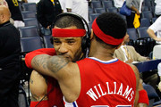 Mo Williams #25 hugs Kenyon Martin #2 of the Los Angeles Clippers after their 82-72 win over the Memphis Grizzlies in Game Seven of the Western Conference Quarterfinals in the 2012 NBA Playoffs at FedExForum on May 13, 2012 in Memphis, Tennessee.  NOTE TO USER: User expressly acknowledges and agrees that, by downloading and or using this photograph, User is consenting to the terms and conditions of the Getty Images License Agreement