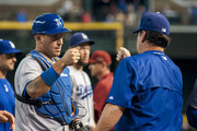 A.J. Ellis #17 of the Los Angeles Dodgers fist pumps coach Rick Honeycutt (R) after defeating the Arizona Diamondbacks 4-3 on September 13, 2015 at Chase Field in Phoenix, Arizona.