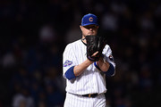 Jon Lester #34 of the Chicago Cubs prepares to throw a pitch during the sixth inning of a game against the Los Angeles Dodgers at Wrigley Field on April 10, 2017 in Chicago, Illinois.