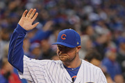 Jon Lester #34 of the Chicago Cubs waves to the crowd during a World Series Championship ring ceremony before a game against the Los Angeles Dodgers at Wrigley Field on April 12, 2017 in Chicago, Illinois.