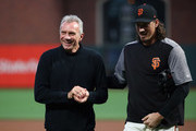 Former NFL quarterback Joe Montana walks off the field with Jeff Samardzija #29 of the San Francisco Giants after he threw out the ceremonial first pitch before the San Francisco Giants game against the Los Angeles Dodgers at AT&T Park on September 12, 2017 in San Francisco, California.
