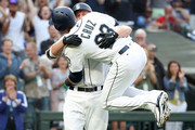 Alternative crop) Kyle Seager #15 celebrates with Nelson Cruz #23 of the Seattle Mariners after hitting a three run home run against the Los Angeles Dodgers in the first inning during their game at Safeco Field on August 18, 2018 in Seattle, Washington.