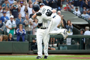 Kyle Seager #15 celebrates with Nelson Cruz #23 of the Seattle Mariners after hitting a three run home run against the Los Angeles Dodgers in the first inning during their game at Safeco Field on August 18, 2018 in Seattle, Washington.